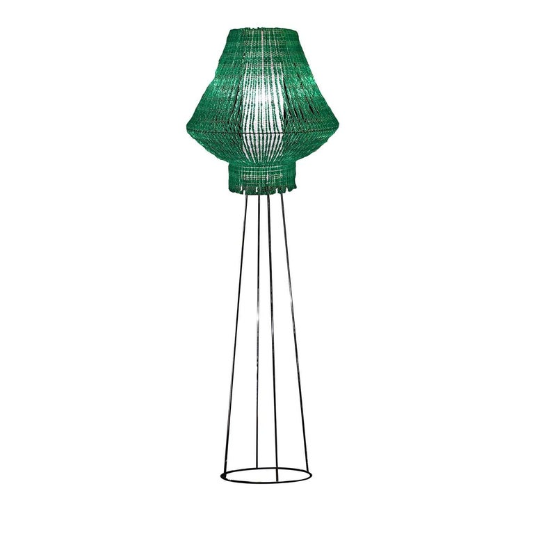 Easily suitable for sophisticated interiors to add a dash of color and texture, this exquisitely handcrafted floor lamp strikes with the vivid green hue of its silhouette. The metal frame sports a glowing chrome finish and supports a diffuser