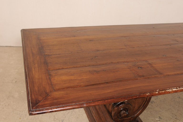 A Peroba Wood Dining or Conference Table w/ Fabulously Thick Carved Scroll Bases In Good Condition For Sale In Atlanta, GA