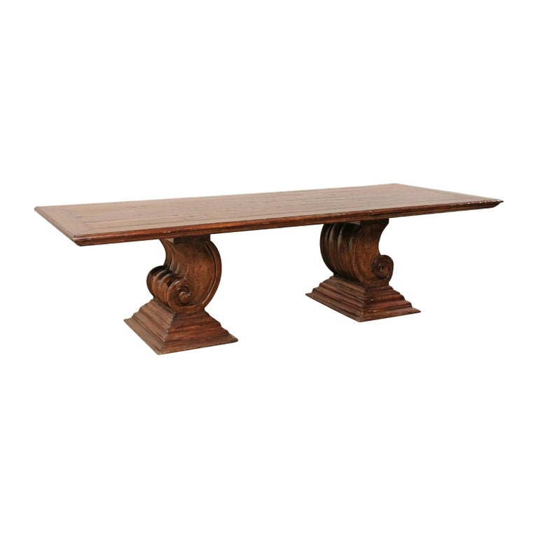 A Peroba Wood Dining or Conference Table w/ Fabulously Thick Carved Scroll Bases For Sale