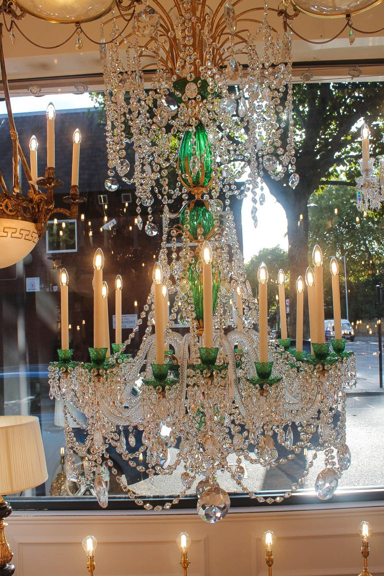 A sixteen light glass and ormolu chandelier by Perry & Parker  The chandelier consists of a main Emerald cut crystal  stem decorated with ormolu. Clear rope twist glass arms are decorated with cut-glass Emerald nozzles and pans with cut glass