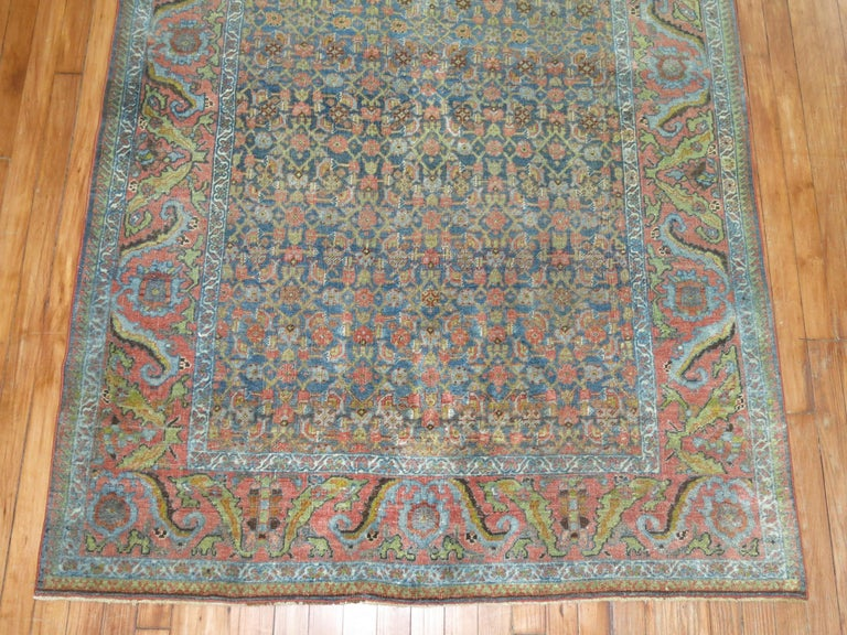 A 20th century Persian Bidjar rug with an all-over Herati design. Accents in blue, light green and pink terracotta. Classic and everlasting. Make sure to check the detailed shots.