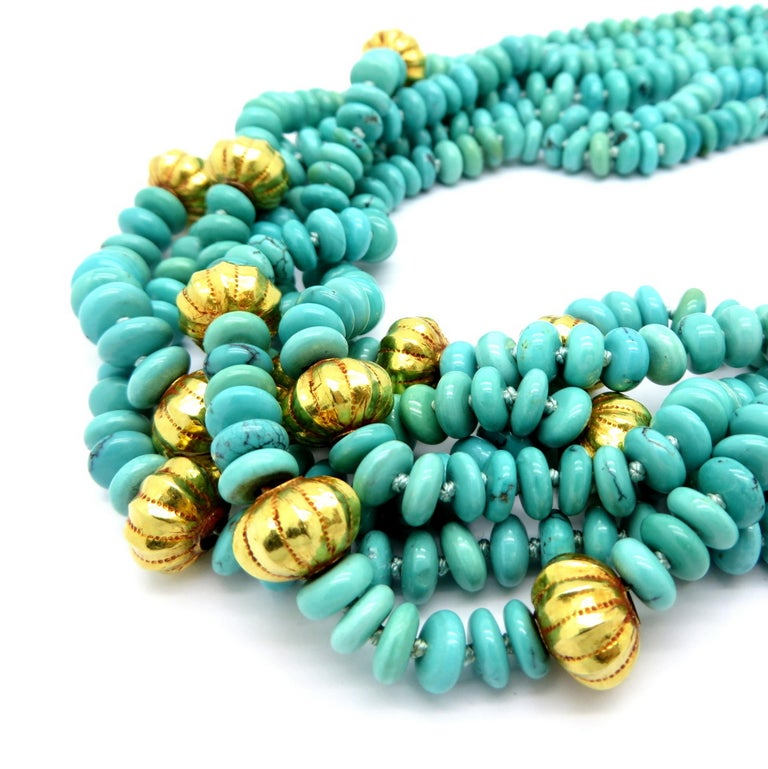 """Persian estate turquoise and gold bead 23K yellow gold fashion necklace. Featuring 14 corrugated 23K yellow gold spacers and six strands with multiple turquoise beads. The necklace measures 19.5"""" inches long. It is secured with a large 23K yellow"""