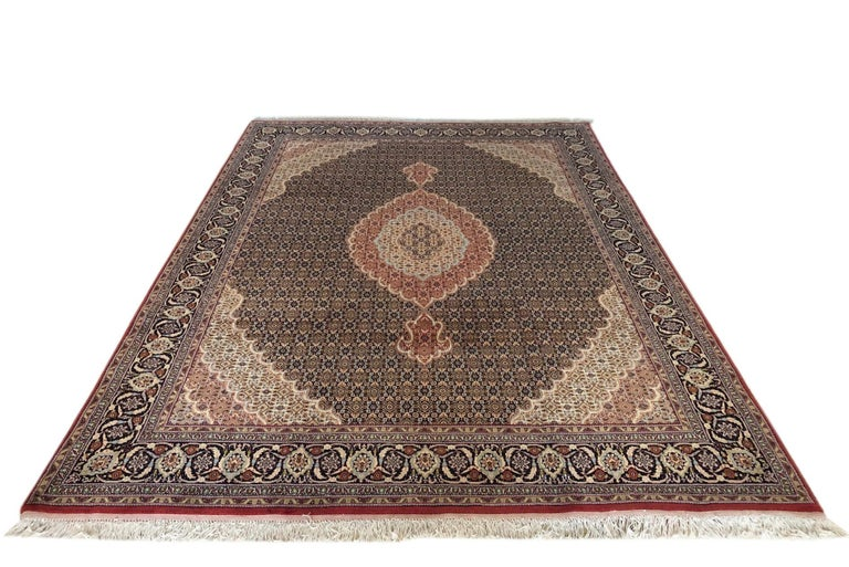This piece is a handmade Persian Bijar rug. The pile is wool and silk with cotton foundation. This beautiful rug is made using high-quality wool, and the knots are beaten down using a heavy metal comb to give a tight, dirt-resistant pile. The Bijar