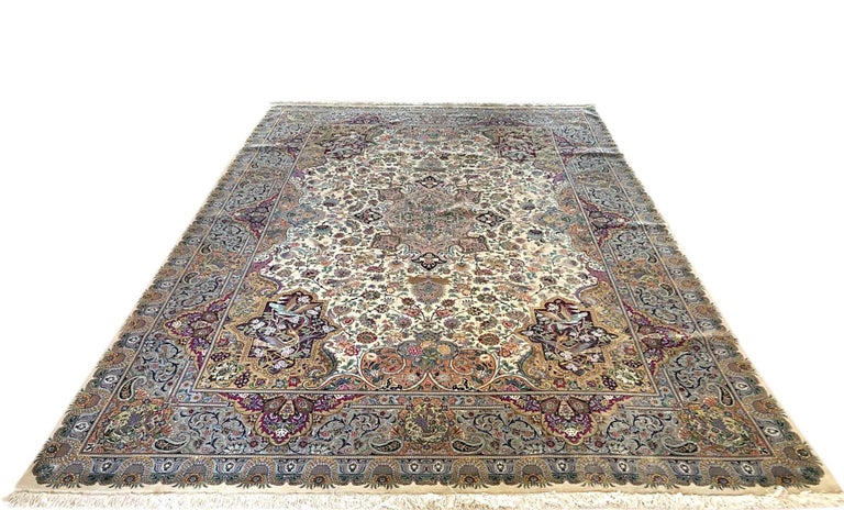 This stunning piece is a hand knotted Persian Tabriz rug with floral design and a very unique oval medallion. The pile is wool and silk with silk foundation. The size is 8 feet 2 inches wide by feet 11 feet 5 inches tall. The base color is cream and