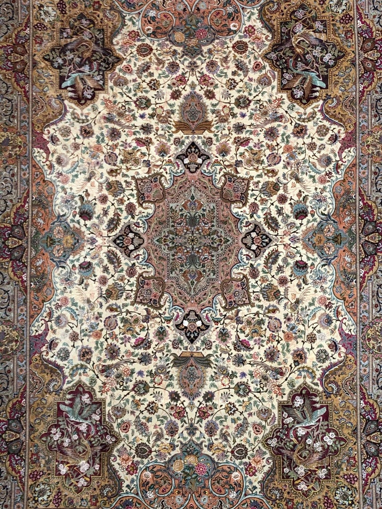 Late 20th Century Persian Hand Knotted Oval Medallion Floral Design Silk Tabriz Rug For Sale