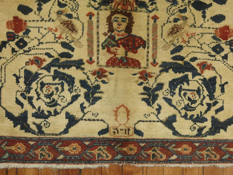 An authentic 20th century Persian Pictorial rug with what looks like a hebrew inscription.