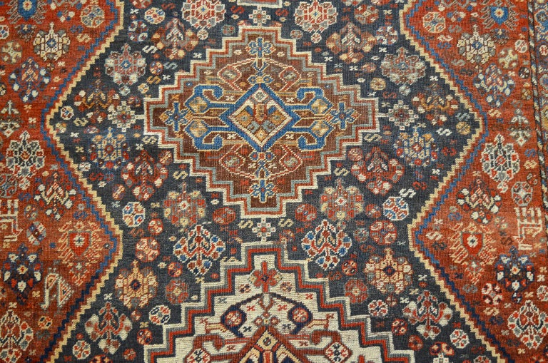 This Persian Qashqai carpet, circa 1880 consists of a pure handspun wool warp, weft and hand knotted pile and organic vegetable dyes. It demonstrates the Classic playful geometric style of these Qashqai pieces utilizing a pleasing overall layout and