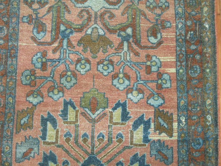 Antique Persian runner with a muted formal palette.