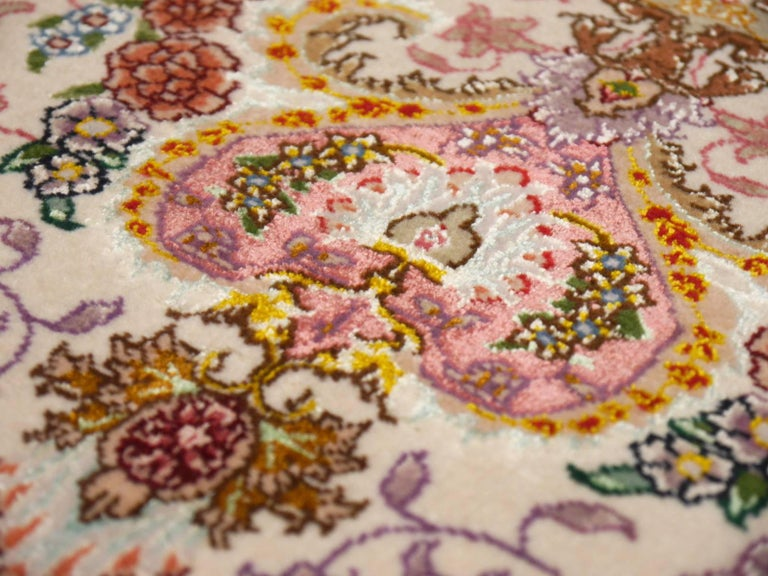 This one of a kind fine Tabriz rug originates from north - western Persia. It was hand knotted in the last quarter of the 20th century. The pile is made of fine lambs wool and pure natural silk. The foundation - warp and weft - is also made of pure