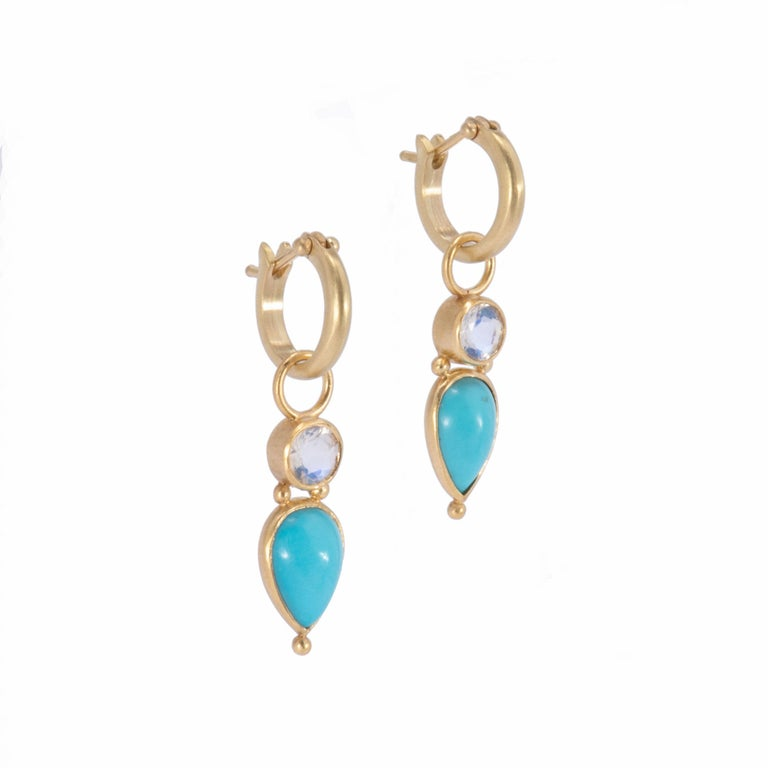 Lush tear drop cabochons of clear sky blue Persian Turquoise sit below faceted round moonstones set in 18k gold. Bezel set with our signature satin finish, these Persian Turquoise & Moonstone Drop Earrings hang from small plain hoops in 18k gold