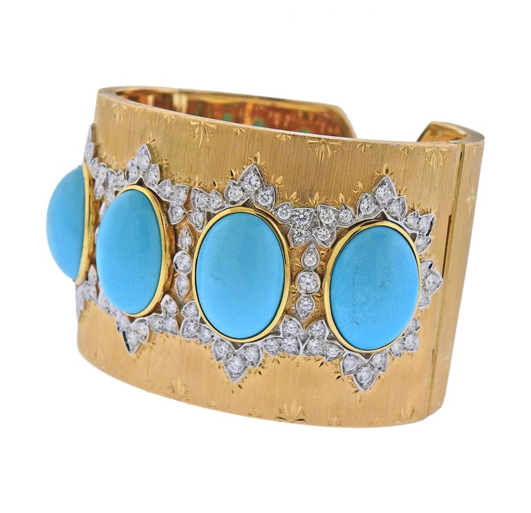 Impressive 18k yellow and white gold wide cuff bracelet, made in Italy, set with approx. 5.80ctw in GH/VS-SI diamonds and 18mm x 13mm Persian turquoise.  Bracelet will fit approx. 7