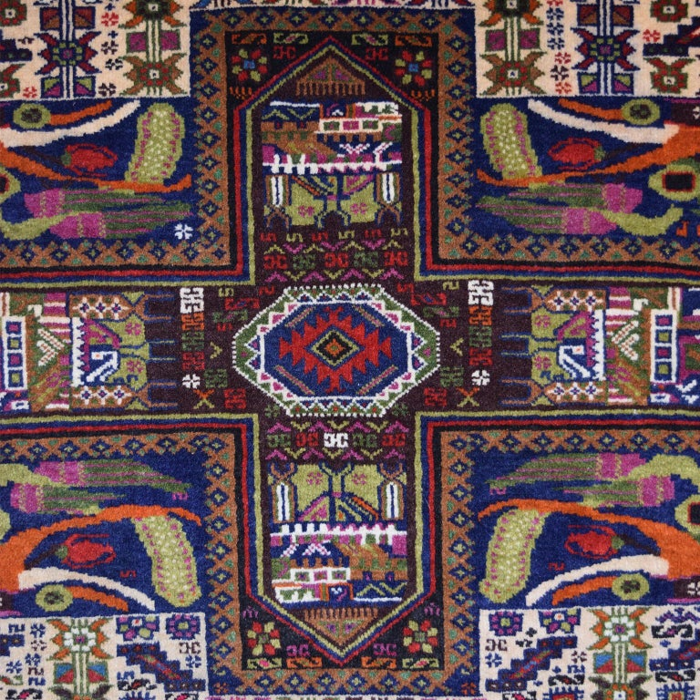 This Persian Zabol carpet circa 1940 in handspun wool and vegetal dyes was created in Zabol in the province of Sistan. This carpet features an overall garden design, with three sets of four intersecting lines dividing the main field. Following