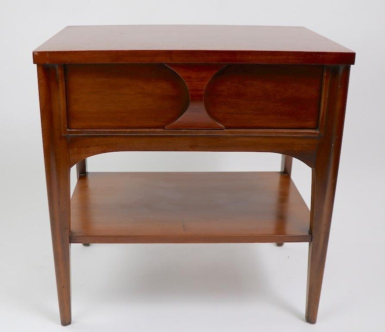 Perspecta line nightstand designed by Kent Coffey. Executed in walnut, elm and rosewood, lower shelf 9 inch H. Originally designed as a night table, this can also double as an end or side table. This example is in good, original condition, showing