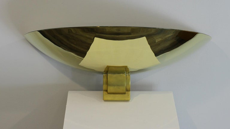 Very rare pair of large sconces attributed to Perzel. We have had a set of seven and this pair is the last one Th shade is in solid brass and has been fully polished, the base is in gilt soldi bronze. All the reflect you can see on the sconces are