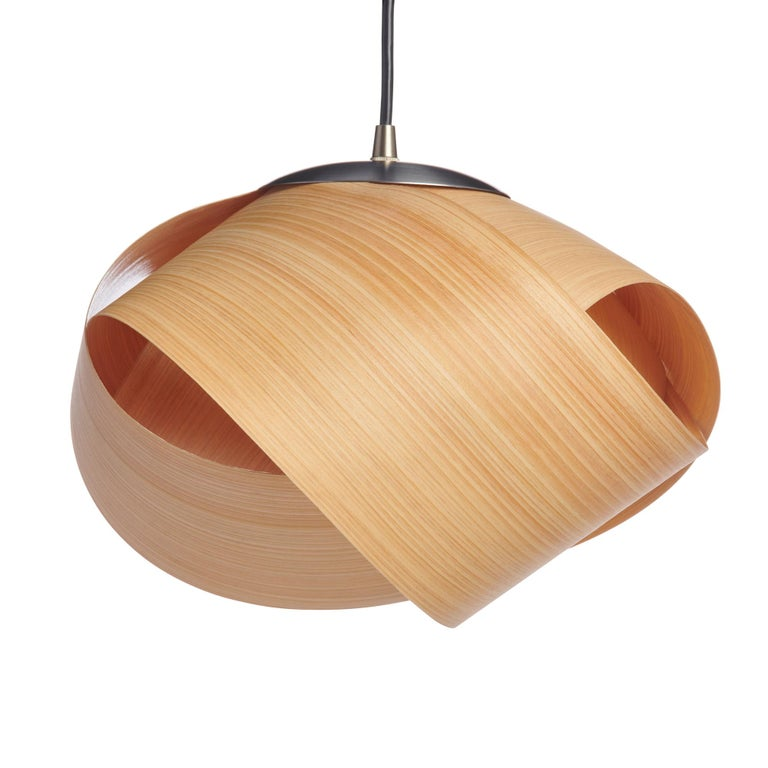 This Mid-Century Modern lighting is an organic modern designer style. This contemporary pendant in cypress wood veneer gives a warm light. There are many luxury design applications for this mini pendant, in pairs over a kitchen island, in entryways