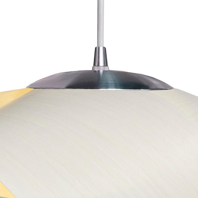 Modern mini pendant in white wood veneer, Petal gives a warm light. It is 14