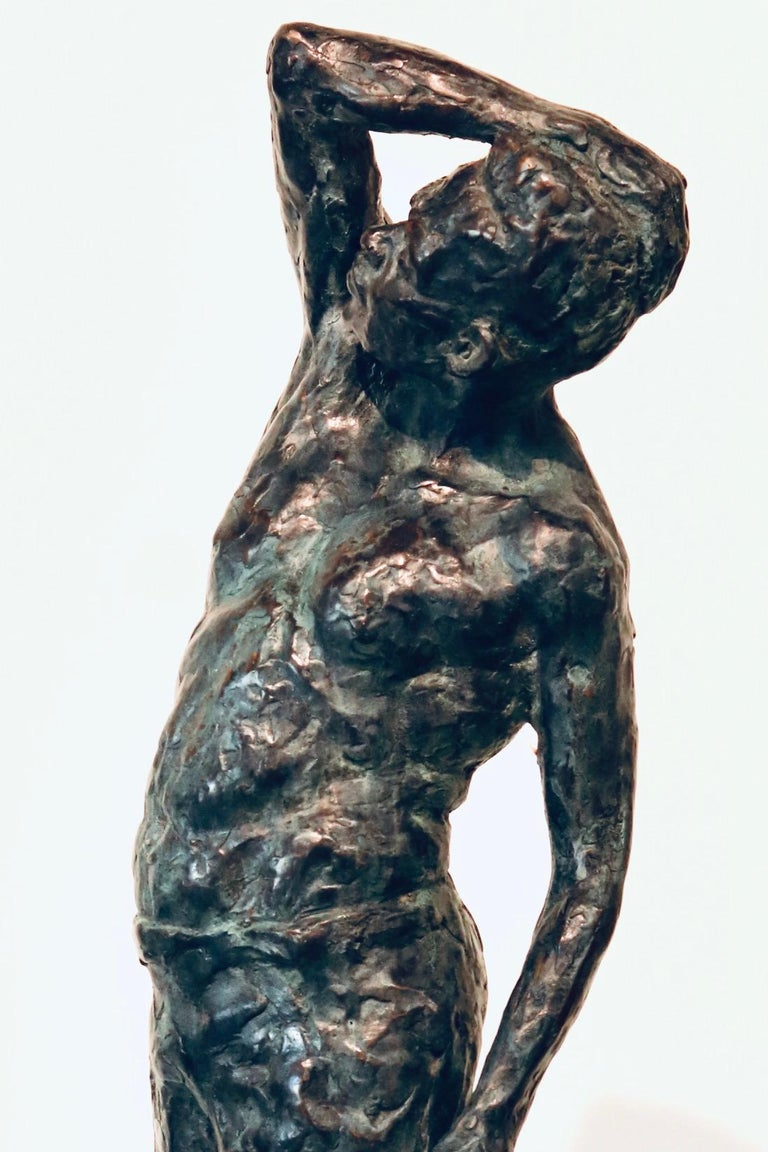 Roy- 21st Century Sculpture of a bare chested male figure standing - Gold Nude Sculpture by Peter Adams