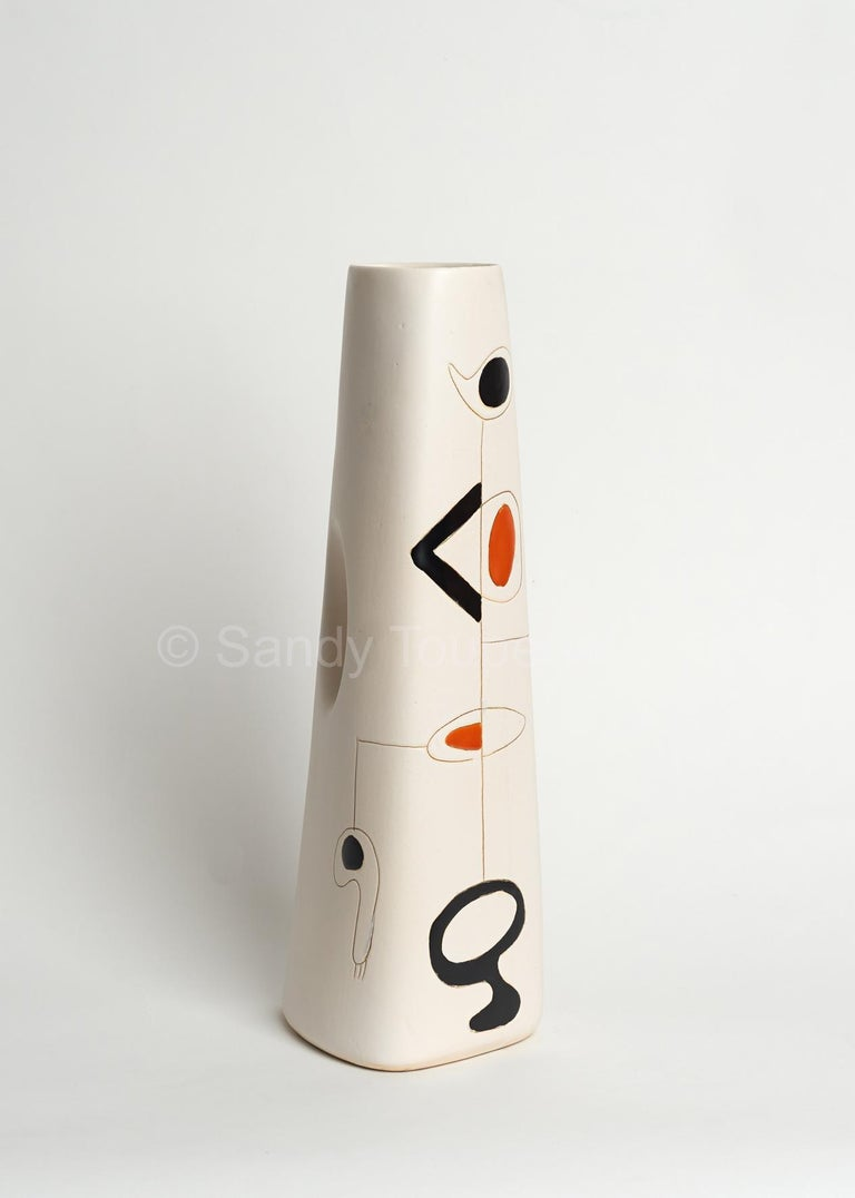 Earthenware vase glazed in white with abstract and geometric decoration engraved and over-glazed in shinny black and orange.