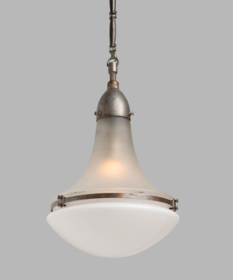 Peter Behrens Luzette pendant, Germany, circa 1920.  Small pendant with frosted glass top and opaline glass bottom, secured with copper fitter and brace. Manufactured by AEG Siemens with manufacturer's mark.