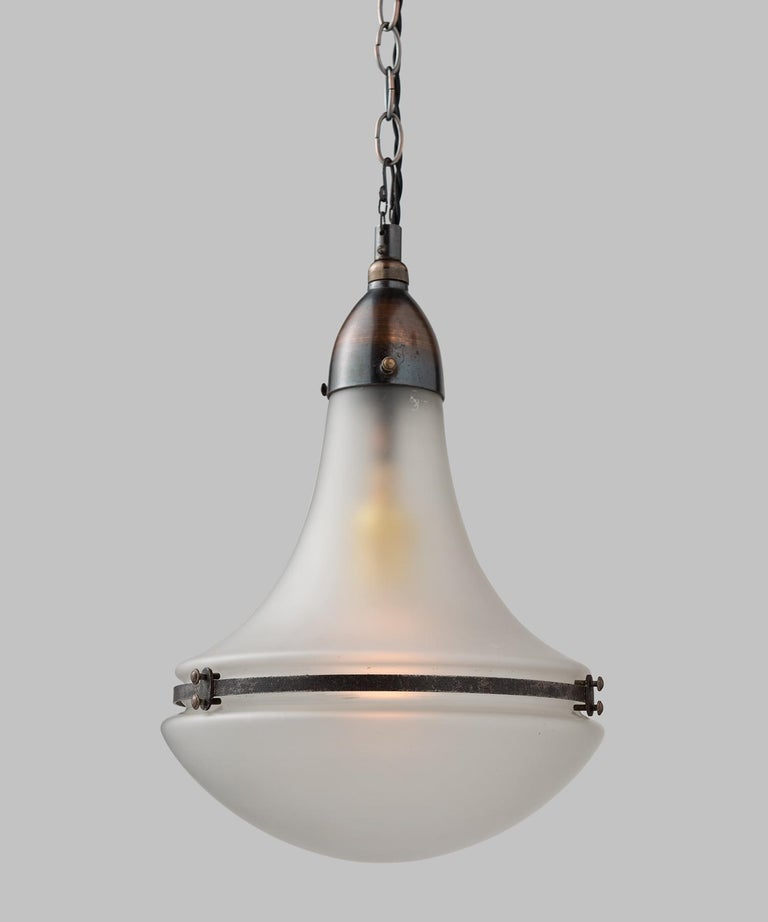 Peter Behrens Luzette pendant, Germany, circa 1920.  Frosted glass shades, secured with copper fitter and brace.  Manufactured by AEG Siemens with manufacturer's mark.  9