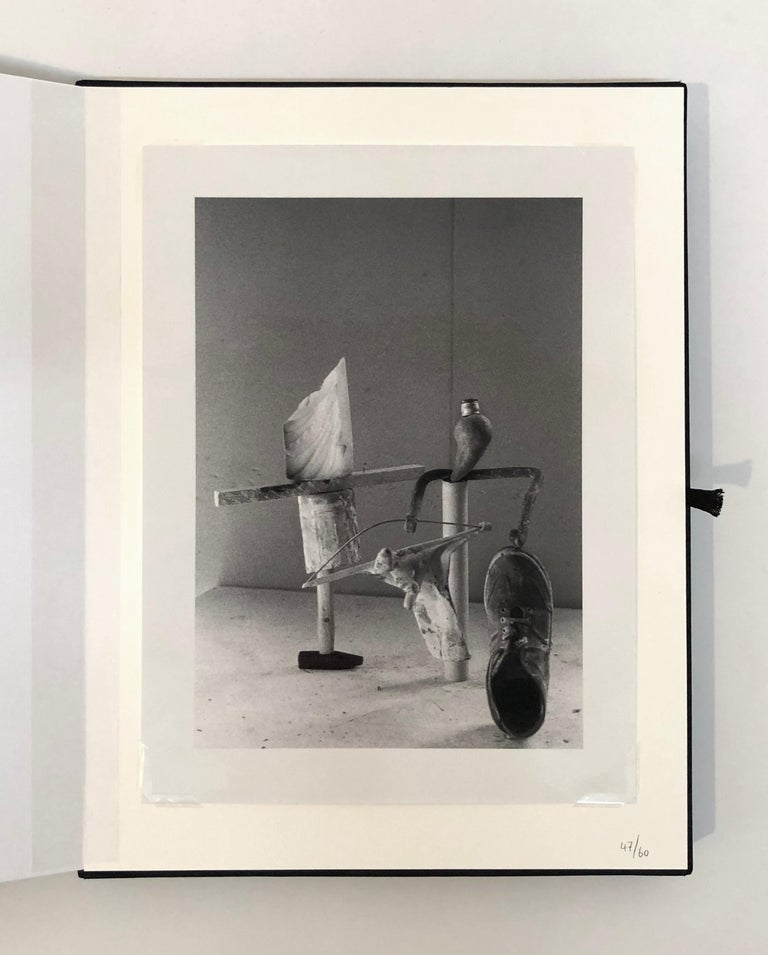 Peter Fischli / David Weiss  Equilibres 184-85/2006 Limited edition book with photograph, in linen bound portfolio Photograph: 12 1/4 x 9 1/8 inches; 31 x 23 cm Book: 9 1/4 x 7 3/4 x 7/8 inches; 24 x 20 x 2 cm Portfolio: 15 x 11 1/2 x 1 1/2 inches;