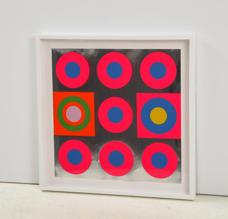 Pop Art screen-print on silver metallic board featuring graphic magenta, blue, orange bullseye targets. Signed Peter Gee 1967. Professionally framed in a white wood frame with glare resistant Plexiglas protector. Numbered 24/50.