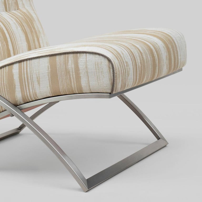Armchair designed by Peter Ghyczy. Manufactured by Ghyczy (Netherlands)   Frame stainless steel matte Fabric Pampelonne (Q5) Piping C, braided leather grey  Dimensions: L 70 x W 70 x SH 41  The construction of this chair is reduced to the