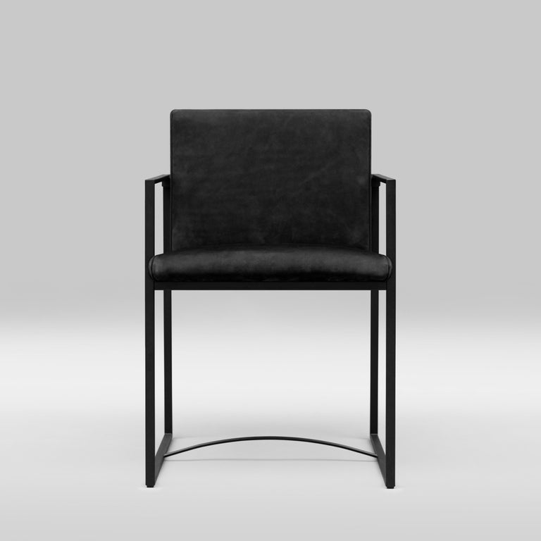 Armchair designed by Peter Ghyczy. Manufactured by Ghyczy (Netherlands)  Dimensions: H 80 x W 52 x SH 47  Frame charcoal Cast part charcoal Fabric O/01 (Q5) No piping.