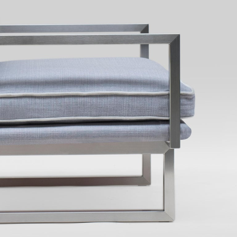 Armchair designed by Peter Ghyczy. Manufactured by Ghyczy (Netherlands)  Frame stainless steel matte Fabric F/30 (Q2) Piping D 'own color'  Dimensions: L 86 x W 90 x SH 41    This sofa has an airy and light weight architectural