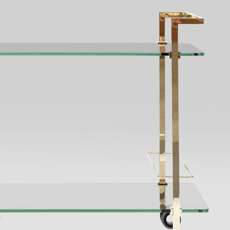 Tea Trolley designed by Peter Ghyczy. Manufactured by Ghyczy (Netherlands)  This slender tea trolley is a piece of art on its own. Two tempered glass plates connect the metal frames. Small cast metal details secure the transparent construction.