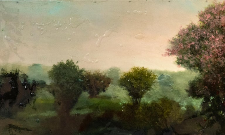 A tall tree, its leaves lit pink and cerise by the glow of a setting sun is framed by an atmospheric mauve sky in this landscape by Peter Hoffer. The painting is finished with a layer of resin and evokes nostalgia for classical forms and