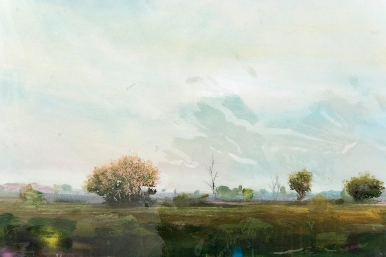 A hazy sky rises above a vast field and distant horizon in this glowing landscape by Peter Hoffer.  Peter Hoffer (b. 1965, Brantford, ON) holds an MFA. from Concordia University and degrees from the University of Guelph and OCAD University. He has