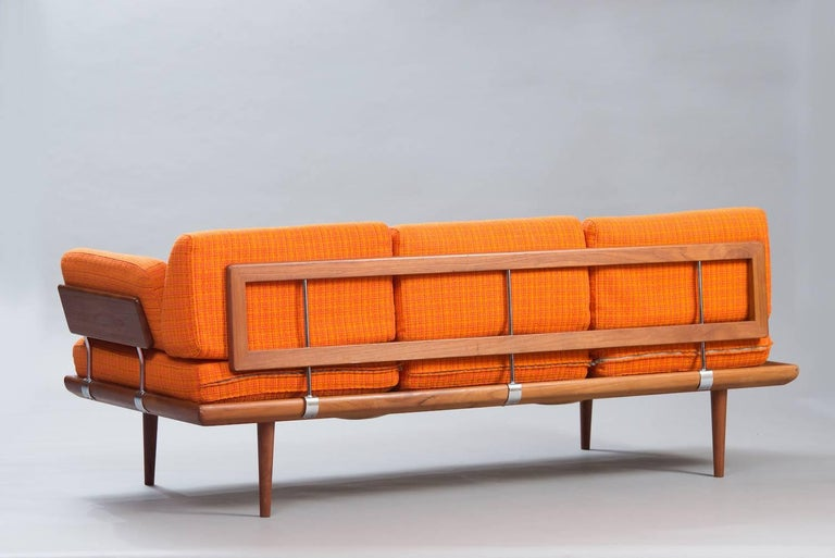 Sofa or daybed 'Minerva', teak and chrome, original orange fabric. Marked.