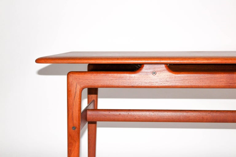 Solid teak coffee table by Danish designers Peter Hvidt and Orla Mølgaard Nielsen. The table has very nice details and shapes. It is in very good vintage condition with some minor signs of usage.