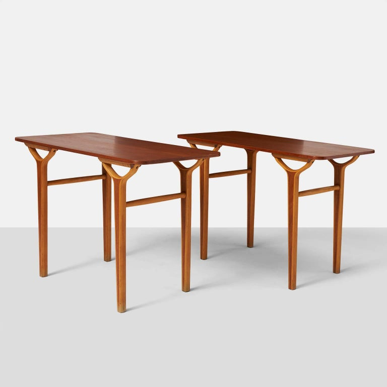 Peter Hvidt & Orla Molgaard Nielsen AX series side tables. A rare pair of side tables in teak and beech form the AX series for Fritz Hansen. Denmark, circa 1950s.