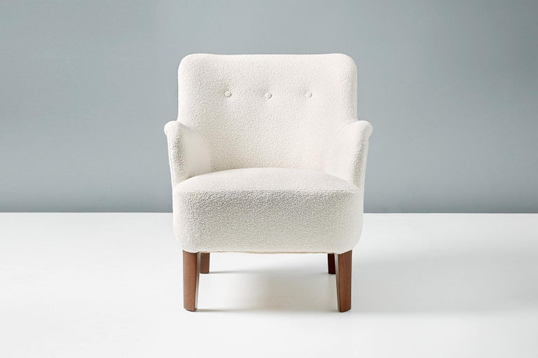 Peter Hvidt  Model 1748 lounge chairs, circa 1940s  These elegant low-back lounge chairs were produced by Fritz Hansen in Denmark in the late 1940s by master designer Peter Hvidt. The beech legs have been walnut-stained and both chairs have been