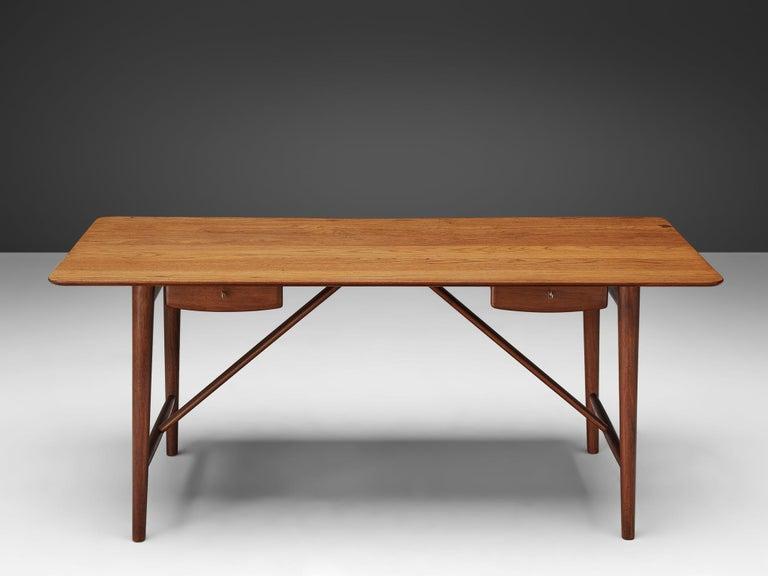 Peter Hvidt and Orla Mølgaard-Nielsen, desk model 310, solid teak, Denmark, 1950s.  Stunning desk designed by Peter Hvidt and Orla Mølgaard-Nielsen. It truly holds the quintessential essence of Danish design with its understated and chic appearance.