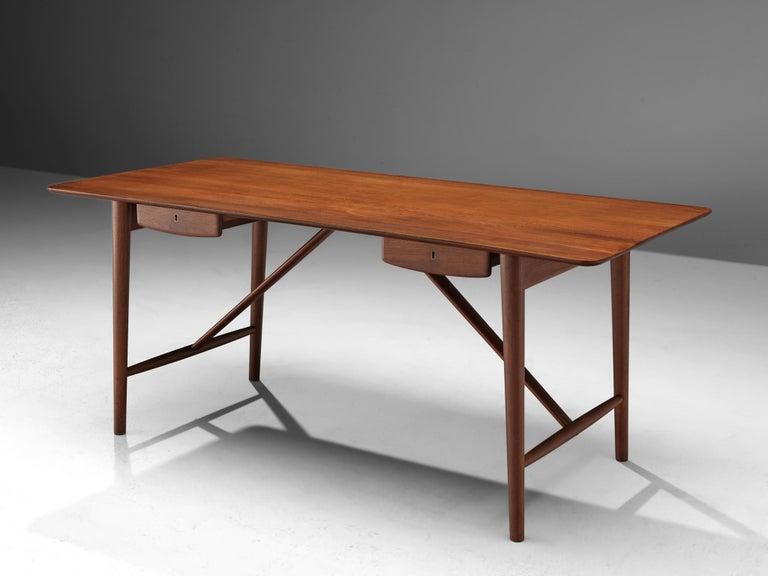 Peter Hvidt and Orla Mølgaard-Nielsen, desk model 310, solid teak, Denmark, 1950s.  Stunning desk designed by Peter Hvidt and Orla Mølgaard-Nielsen. It truly holds the quintessential essence of Danish design with its understated and chic