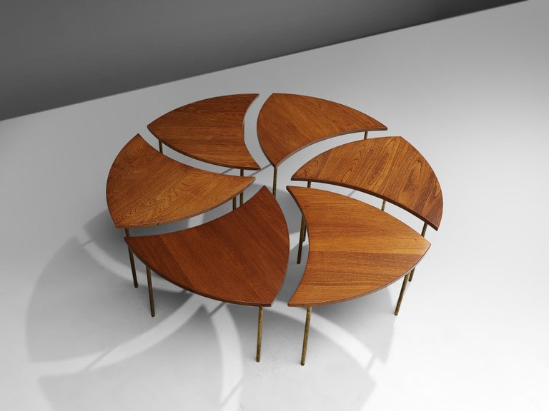 Peter Hvidt and OrlaMølgaard Nielsen coffee table 'FD 523', teak, brass, Denmark, 1950s.  A modular coffee table, consisting of six organic triangular segments that form together one large round coffee table or different dynamic shapes. The legs