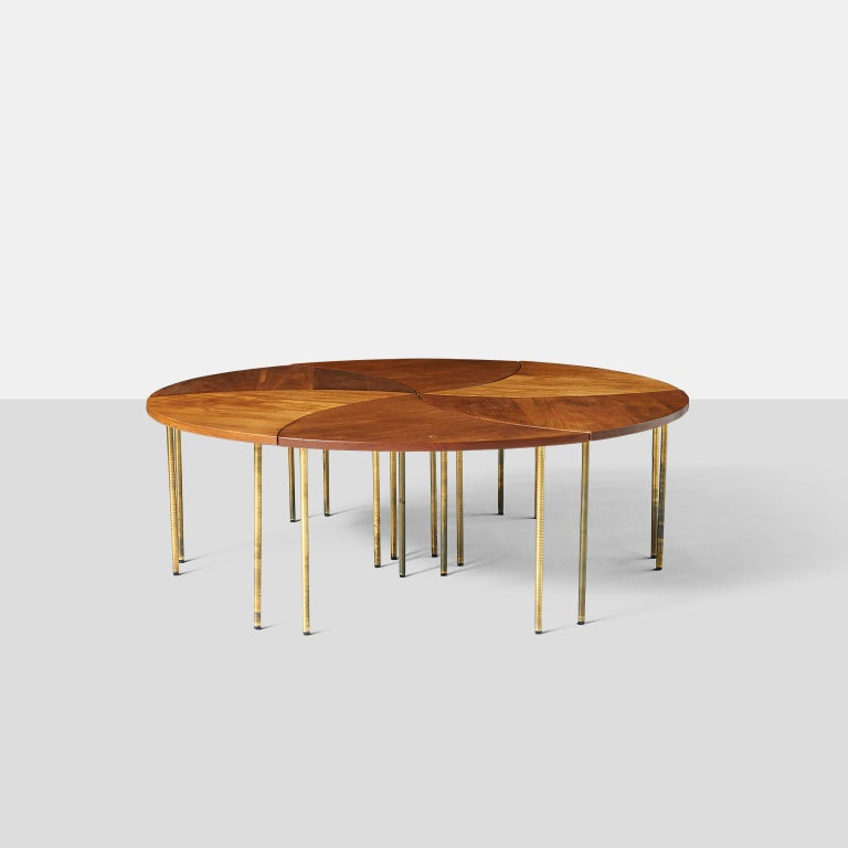 Peter Hvidt coffee table model #523 A 6 piece coffee table by Peter Hvidt and known as the pinwheel table. The table can be arranged in multiple shapes and is made in teak with brass legs. Original labels are still attached. Denmark, circa 1952.