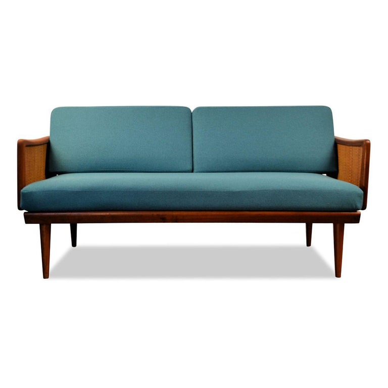 Vintage two-seat sofa designed by the famous Danish designer duo Peter Hvidt & Orla Mølgaard-Nielsen for France & Daverkosen. This model 451 features a typical 1950s Danish design, a lovely combination of teak wood and rattan and new high quality