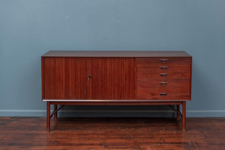 Peter Hvidt & Orla Mølgaard Nielsen design teak credenza, Denmark. High quality construction and attention to detail with dovetail construction in solid teak.