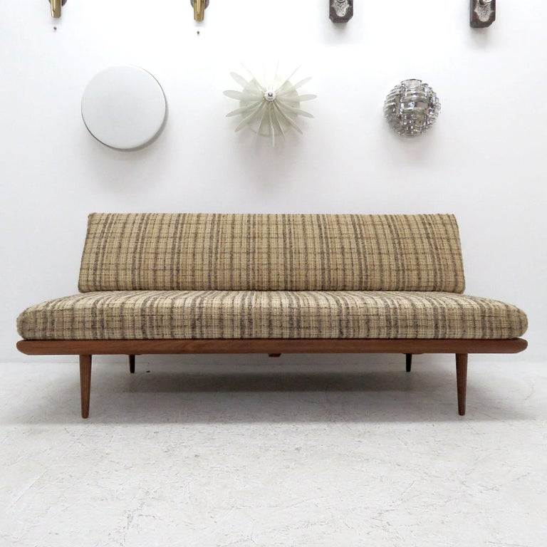 Wonderful daybed/sofa model FD 417 'Minerva' by Peter Hvidt & Orla Mølgaard Nielsen for France & Son, Denmark, 1960s with original spring core seat and back cushions, in original textured wool upholstery on a solid teak frame. Marked with original