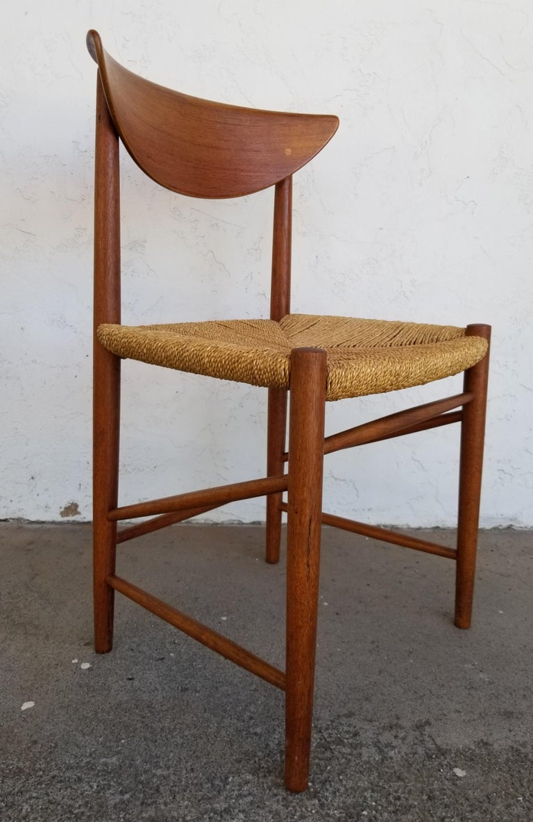 An exceptional set of 10 teak Danish modern dining chairs by Peter Hvidt & Orla Mølgaard-Nielsen. Original finish with wonderful glow to patina. Original grass cord or wicker seats in very good original condition. Set consists of nine side chairs