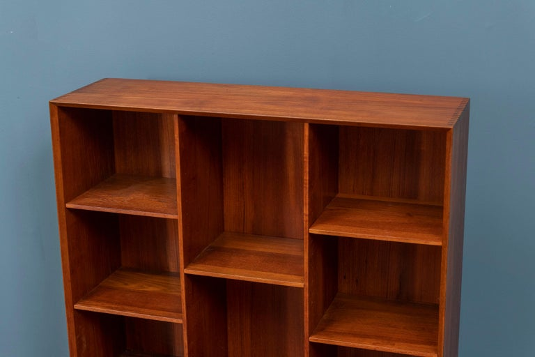 Peter Hvidt & Orla Molegaard Nielsen design teak bookcase with five adjustable shelves, signed. High quality construction and newly refinished.