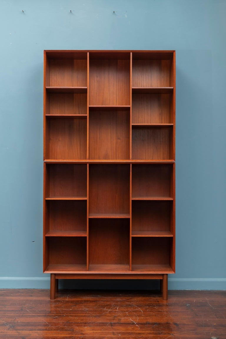 Peter Hvidt & Orla Mølgaard Nielsen teak two piece bookcase with adjustable shelves, newly restored. Two of the shelves are new replacements.