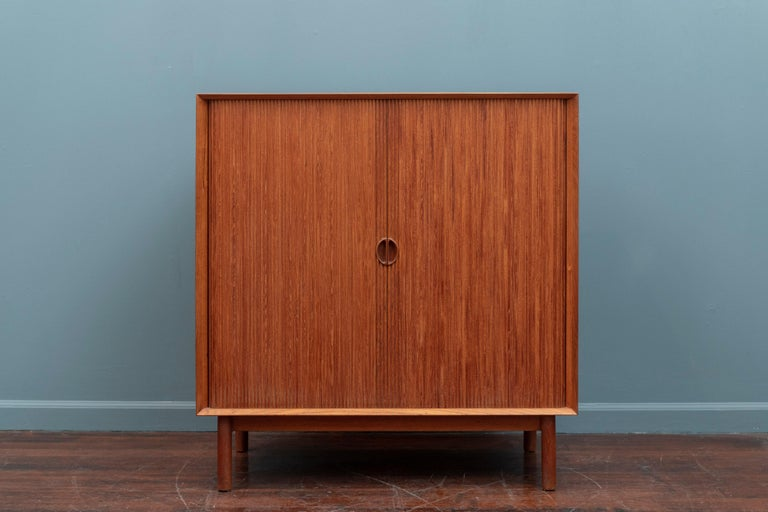 Peter Hvidt & Orla Molgaard Nielsen teak cabinet made from solid teak with a tambour door. High quality construction and design details, stamped.
