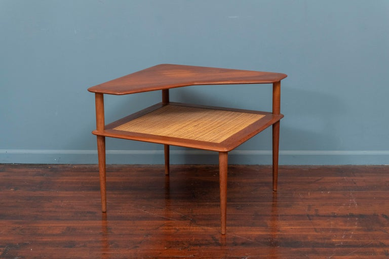 Peter Hvidt & Orla Moregaard design teak two tiered corner table with a cane insert. Very good condition ready to install, labeled.