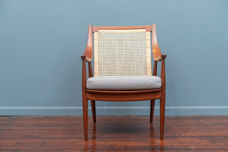 Peter Hvidt & Orla Morgaard Nielsen design armchair, Denmark. Refinished teak wood frame with a newly caned backrest, upholstered cushion and new seat straps. Extremely comfortable and ready to install.