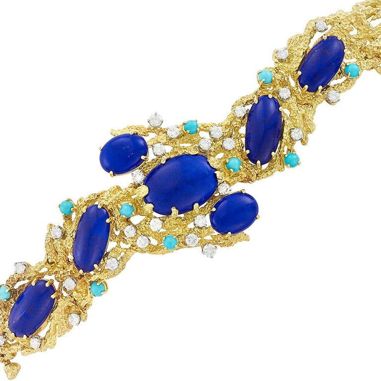 One of a kind vintage designer bracelet made with lapis, diamonds and Persian turquoise set into textured 18K gold, Peter Lindeman.  Stylish and beautiful statement piece that can be worn for any occasion. Looks great with jeans or dressed